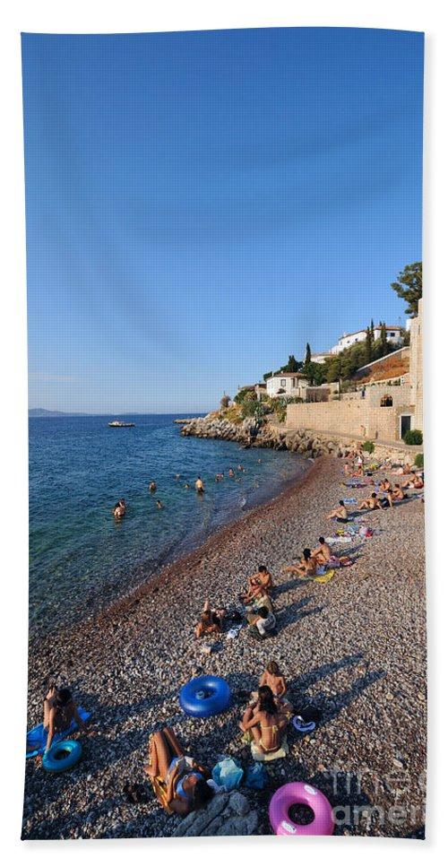 Hydra; Idra; Kaminia; Kamini; Mikro Kamini; Greece; Hellas; Greek; Hellenic; Argosaronic; Saronic; Gulf; Islands; Beach; People; Tourists; Swim; Swimming; Sunbathing; Suntanning; Suntan; Tanning; Castello; Cafe; Cafeteria; Island; Bar; Restaurant; Inn; Holidays; Vacation; Travel; Trip; Voyage; Journey; Tourism; Touristic; Summer; Sunny; Sea; Blue; Sky Beach Towel featuring the photograph Mikro Kamini Beach by George Atsametakis