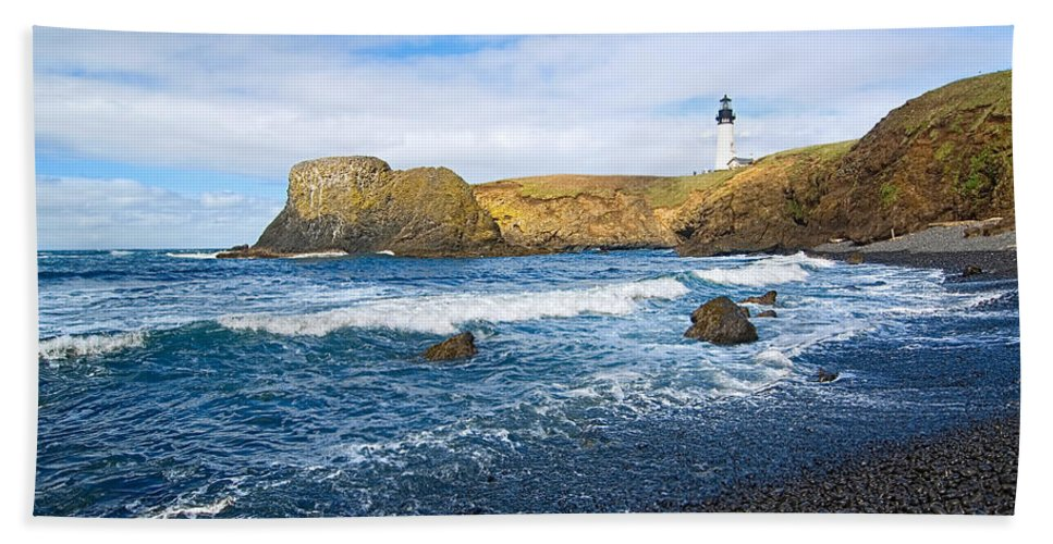 Yaquina Lighthouse Beach Towel featuring the photograph Yaquina Lighthouse On Top Of Rocky Beach by Jamie Pham