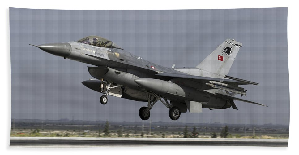 Military Beach Towel featuring the photograph A Turkish Air Force F-16c Fighting by Daniele Faccioli
