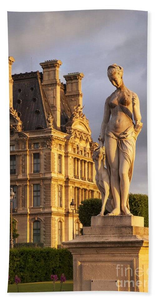 Architecture Beach Towel featuring the photograph Statue Below Musee Du Louvre by Brian Jannsen