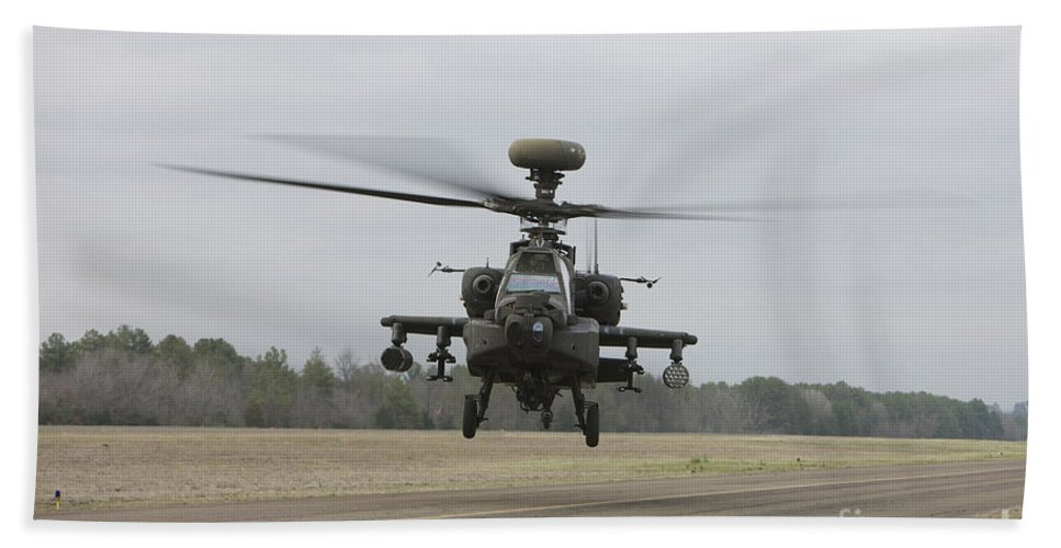 Aircraft Beach Towel featuring the photograph An Ah-64 Apache Helicopter In Midair by Terry Moore