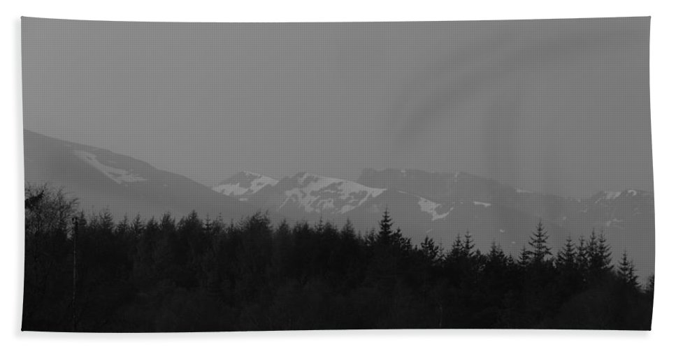 Blue Sky Beach Towel featuring the photograph Treeline With Ice Capped Mountains In The Scottish Highlands by Ashish Agarwal