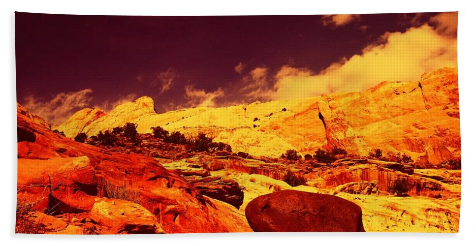 Beach Towel featuring the photograph A Black Rock And Blue Sky by Jeff Swan