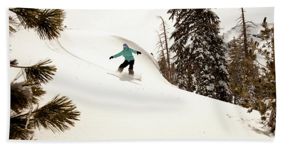 California Beach Towel featuring the photograph A Female Snowboarder Lays Out Some by Kyle Sparks