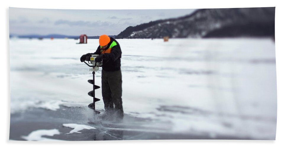 Auger Beach Towel featuring the photograph A Ice Fisherman Uses An Auger To Drill by David McLain