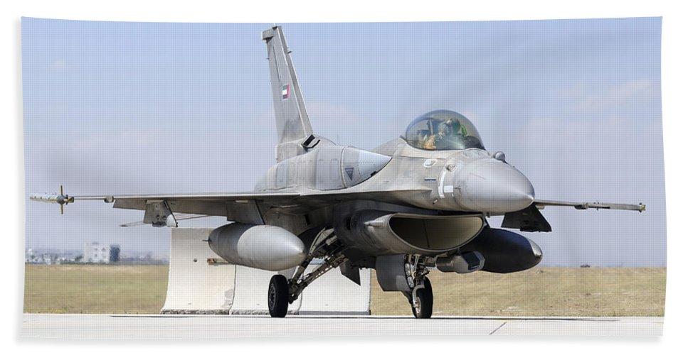 Military Beach Towel featuring the photograph A United Arab Emirates Air Force F-16e by Daniele Faccioli