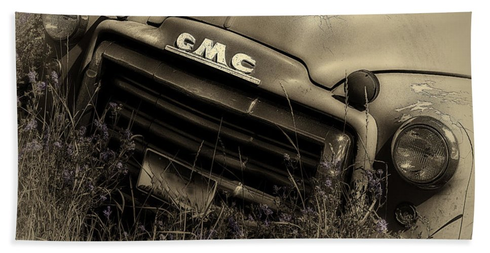 Gmc Beach Towel featuring the photograph A Weather-beaten Classic by John Vose