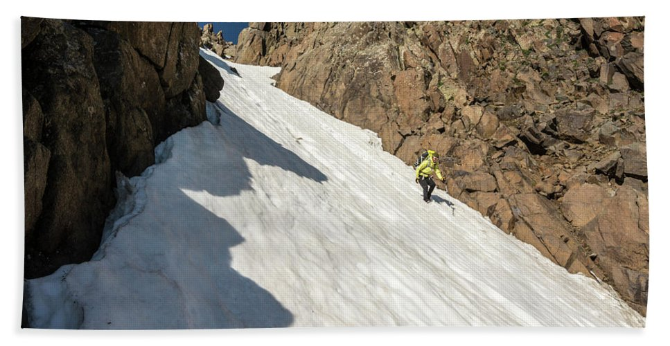 Low Angle View Beach Towel featuring the photograph A Woman Descending A Snow Slope While by Kennan Harvey