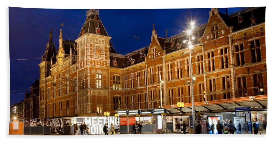 Central Beach Towel featuring the photograph Amsterdam Central Station And Tram Stop At Night by Artur Bogacki