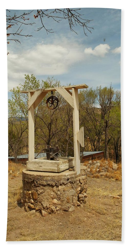 Water Beach Towel featuring the photograph An Old Well In Lincoln City New Mexico by Jeff Swan