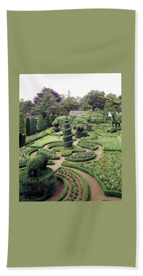 Exterior Beach Sheet featuring the photograph An Ornamental Garden by Tom Leonard