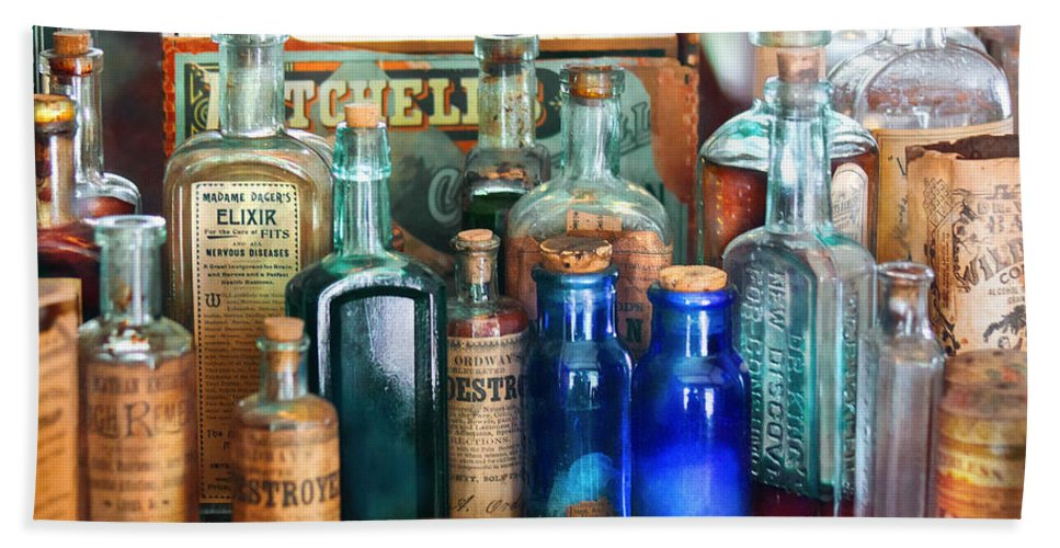 Pharmacy Beach Towel featuring the photograph Apothecary - Remedies For The Fits by Mike Savad