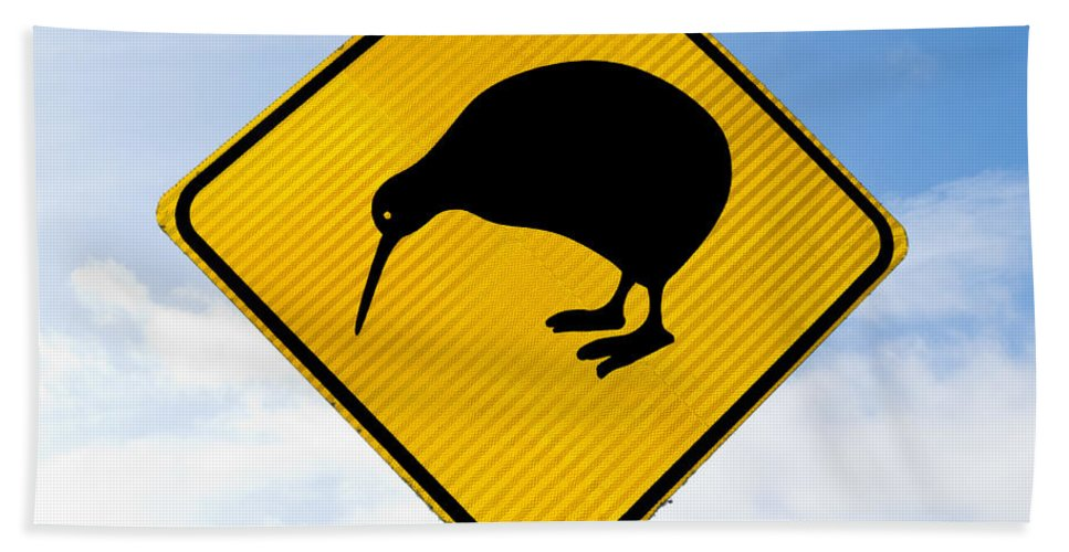 Animal Beach Towel featuring the photograph Attention Kiwi Crossing Road Sign by Stephan Pietzko