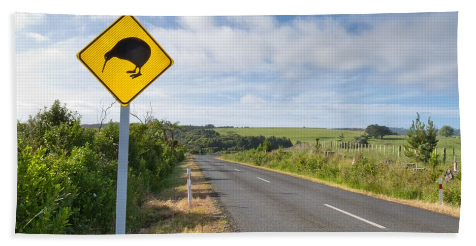 Animal Beach Towel featuring the photograph Attention Kiwi Crossing Roadsign At Nz Rural Road by Stephan Pietzko