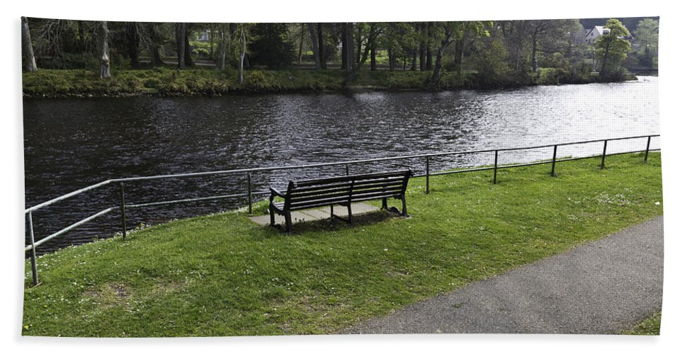 Bench Beach Towel featuring the photograph Bench On Shore Of River Ness In Inverness by Ashish Agarwal