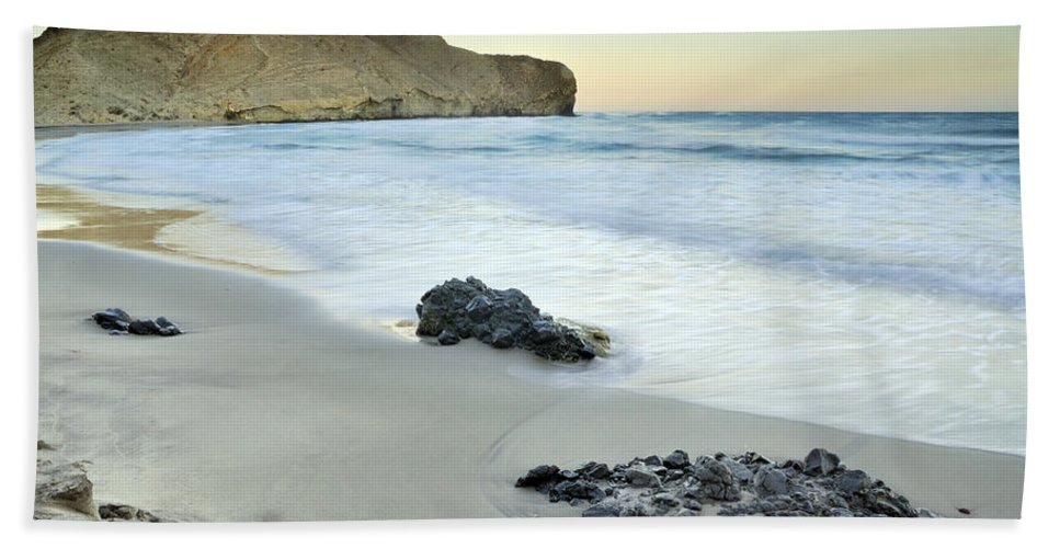 Seascape Beach Towel featuring the photograph Black Volcanic Rocks by Guido Montanes Castillo