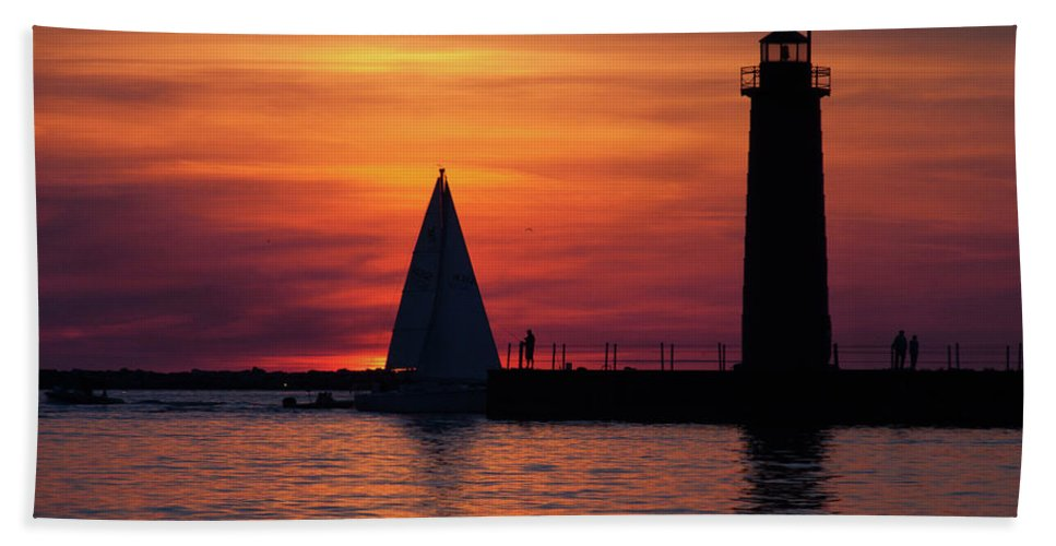 Nautical Beach Towel featuring the photograph Boats Entering The Channel At The Muskegon Lighthouse by John Harmon