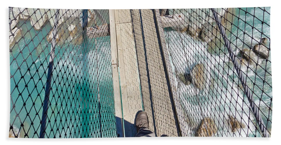 Activity Beach Towel featuring the photograph Boots On Swing Bridge Over Troubled White Water by Stephan Pietzko