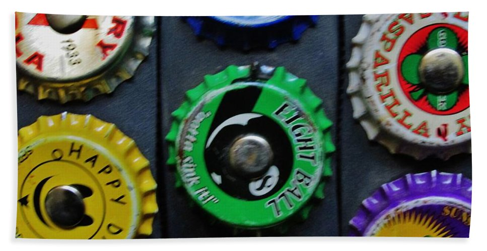 Tops Beach Towel featuring the photograph Bottle Tops by Don Baker