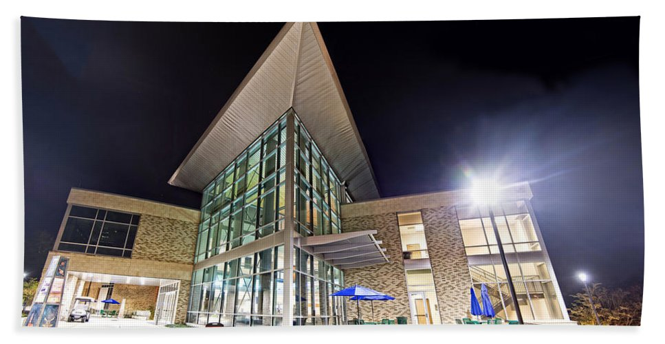 Uwf Beach Towel featuring the photograph Business Building At Night by Jon Cody