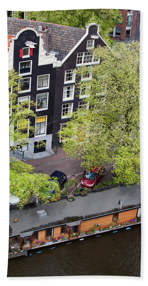 Amsterdam Beach Towel featuring the photograph Canal Houses And Houseboat In Amsterdam by Artur Bogacki