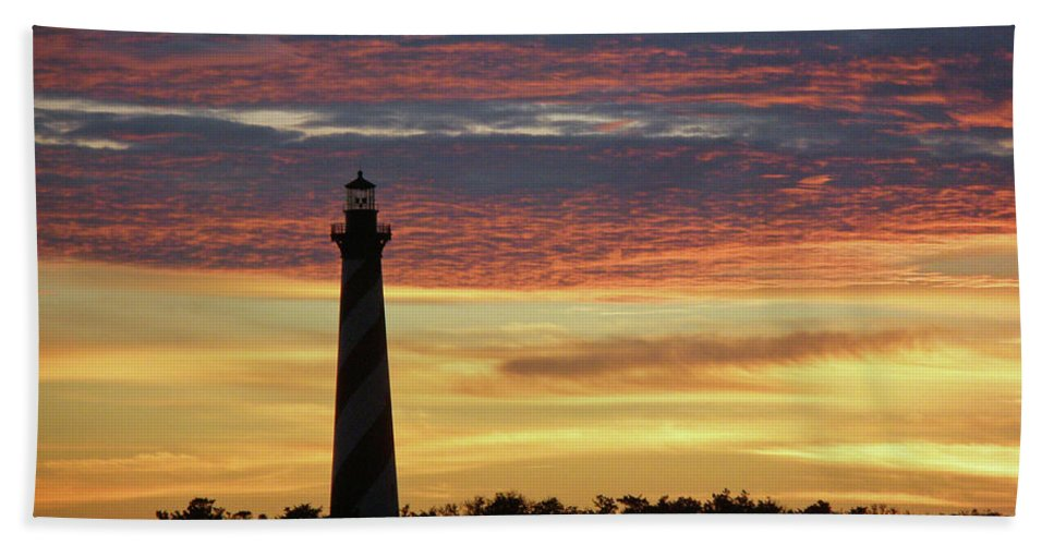 Lighthouse Beach Towel featuring the photograph Cape Hatteras Lighthouse At Sunset by Mother Nature