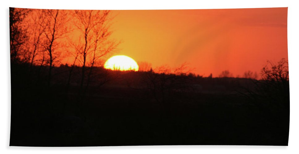 Sunset Land Trees Forest Northern Saskatchewan Land Of The Living Skies Nature Sky Orange Glow Beach Towel featuring the photograph Catching The Sunset by Andrea Lawrence