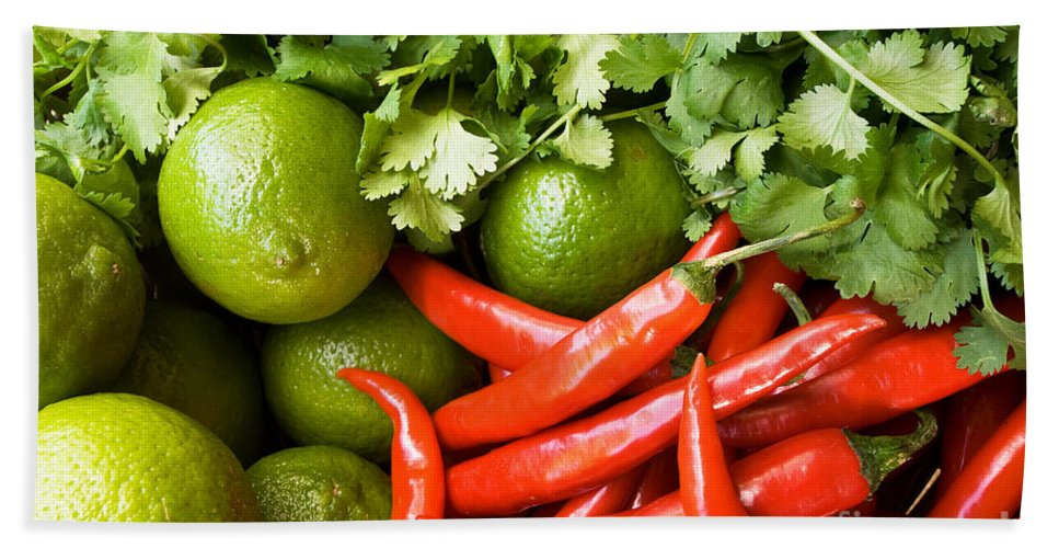 Red Beach Towel featuring the photograph Chillies And Limes by Rick Piper Photography