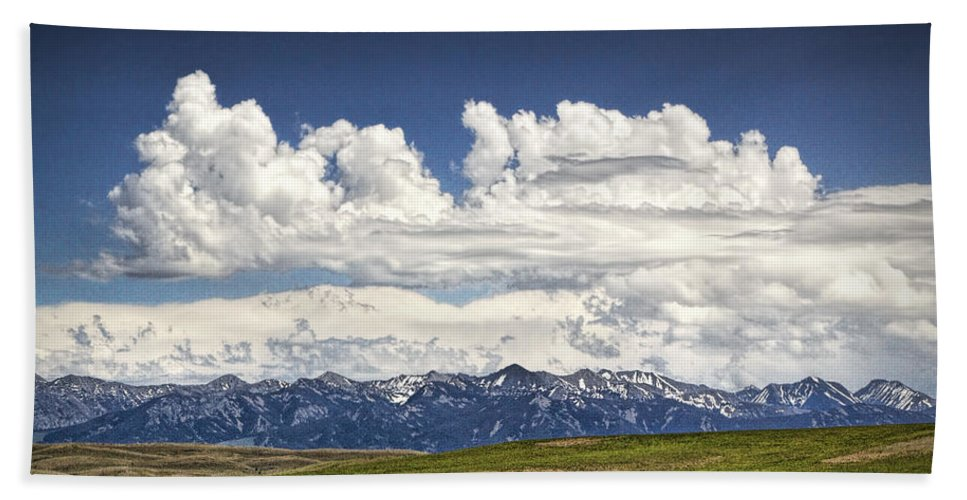 Art Beach Towel featuring the photograph Clouds Over A Mountain Range In Montana by Randall Nyhof