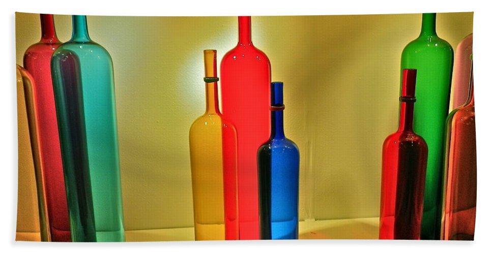 Nostalgic Beach Towel featuring the photograph Colorful Glass Bottles by Anna Ruzsan