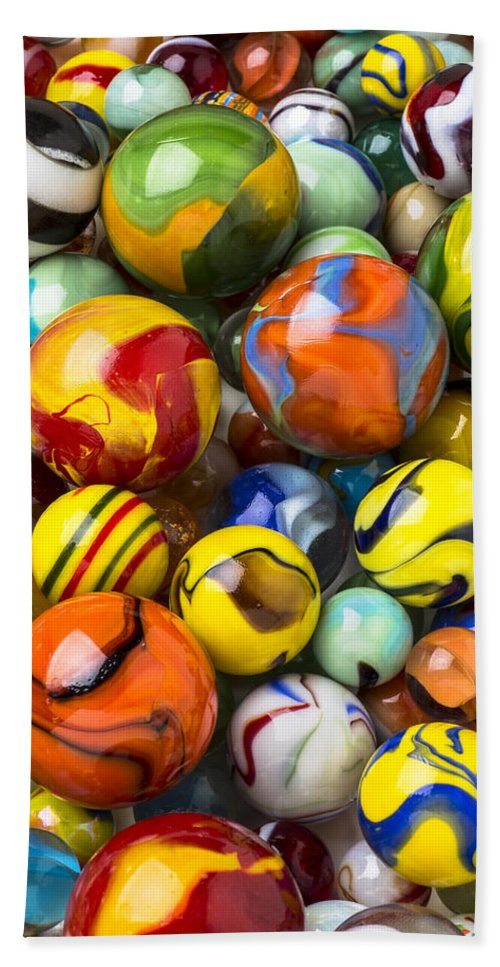 Pile Beach Towel featuring the photograph Colorful Glass Marbles by Garry Gay