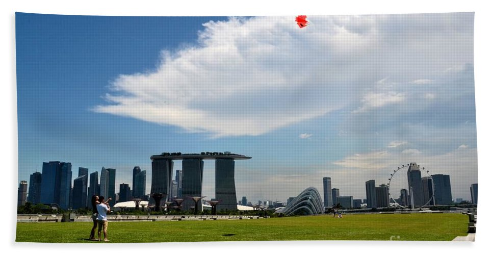 Singapore Beach Towel featuring the photograph Couple Flies Kite Marina Bay Sands Singapore by Imran Ahmed