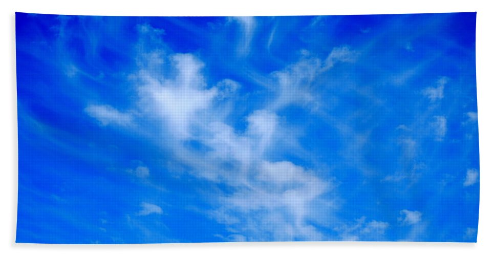 Blue Beach Towel featuring the photograph Cris Cross Clouds by Kathy Sampson
