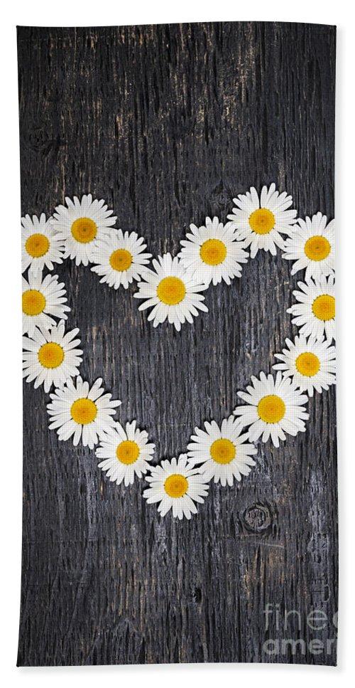 Daisy Beach Towel featuring the photograph Daisy Heart On Dark Wood by Elena Elisseeva
