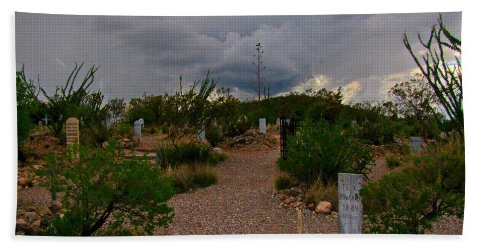 Dark Sky Over Tombstone Beach Towel featuring the photograph Dark Sky Over Tombstone by John Malone