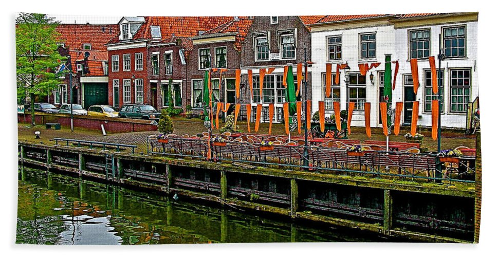 Decorations For Orange Day To Celebrate The Queen's Birthday In Enkhuizen Beach Towel featuring the photograph Decorations For Orange Day To Celebrate The Queen's Birthday In Enkhuizen-netherlands by Ruth Hager