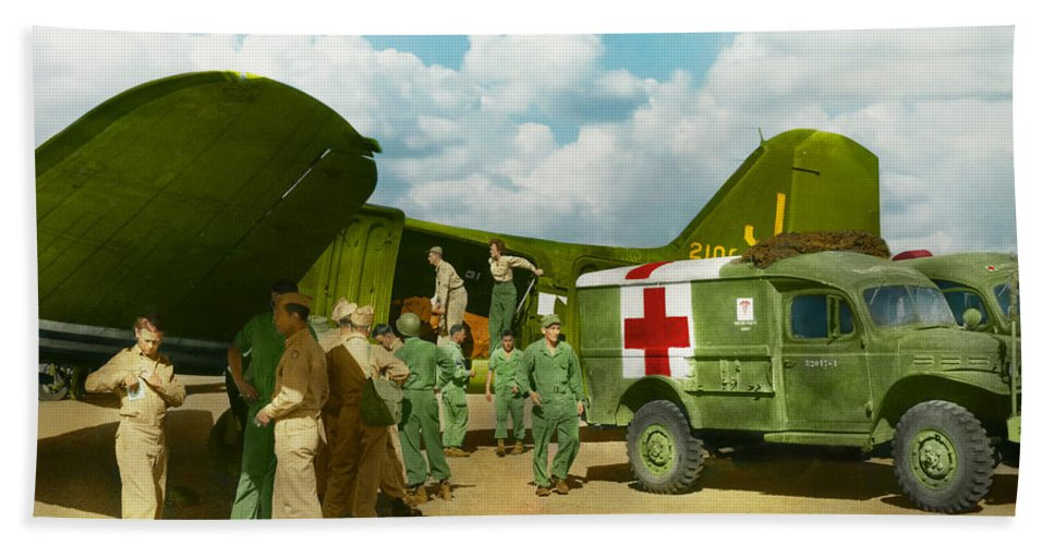 C-47 Beach Towel featuring the photograph Doctor - Transferring The Wounded by Mike Savad