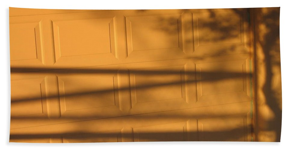 Film Noir Caught 2 1949 Shadow On Garage Door Casa Grande Arizona. 2004 Beach Towel featuring the photograph Film Noir Caught 2 1949 Shadow On Garage Door Casa Grande Arizona. 2004 by David Lee Guss