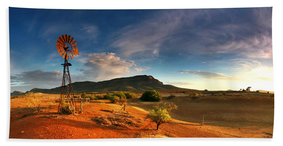 First Light Early Morning Windmill Dam Rawnsley Bluff Wilpena Pound Flinders Ranges South Australia Australian Landscape Landscapes Outback Red Earth Blue Sky Dry Arid Harsh Beach Towel featuring the photograph First Light On Wilpena Pound by Bill Robinson