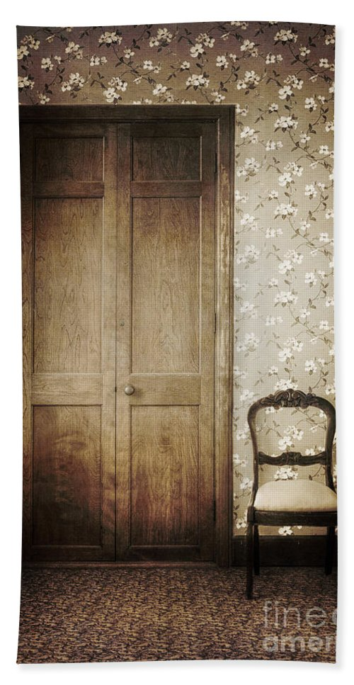 Chair; Empty; Minimal; Dirty; Old; Vintage; Sepia; No One; Inside; Interior; Indoors; Foyer; Floor; Wall; Wood; Hall; Wallpaper; Door; Doorway; Closed; Still Life; Rug; Carpet; Floral; Pattern Beach Towel featuring the photograph Floral Patterns by Margie Hurwich