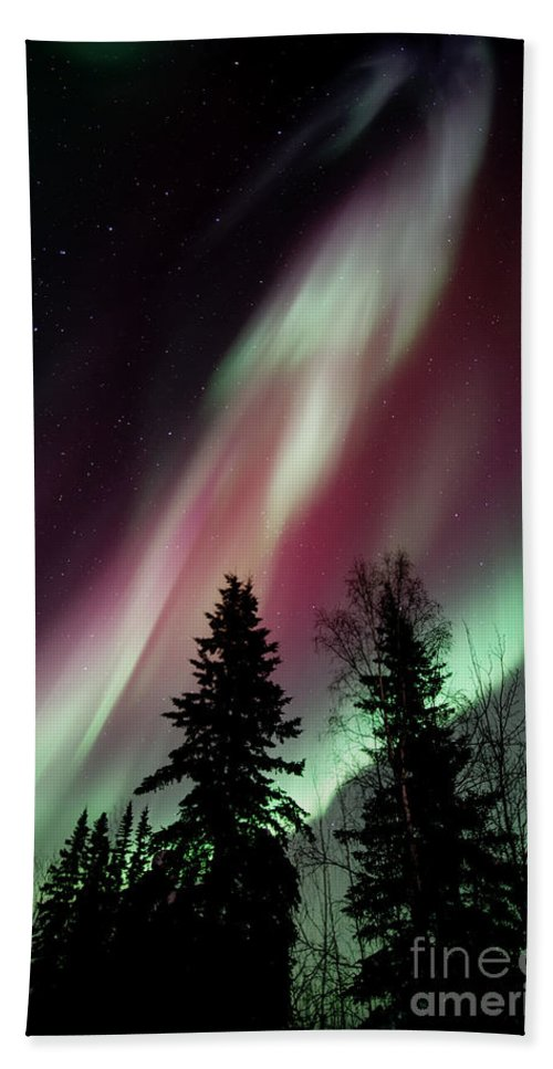 Northern Light Beach Towel featuring the photograph Flowing Colours by Priska Wettstein