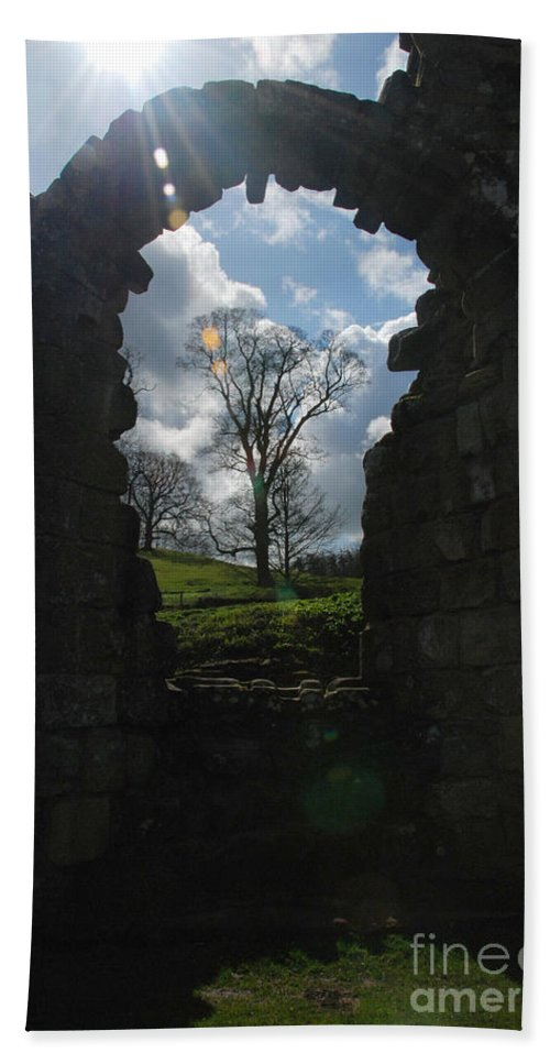 Fountains Abbey Yorkshire Uk Stone Wall Window Sun Ray Tree Arch Beach Towel featuring the photograph Fountains Abbey by Richard Gibb
