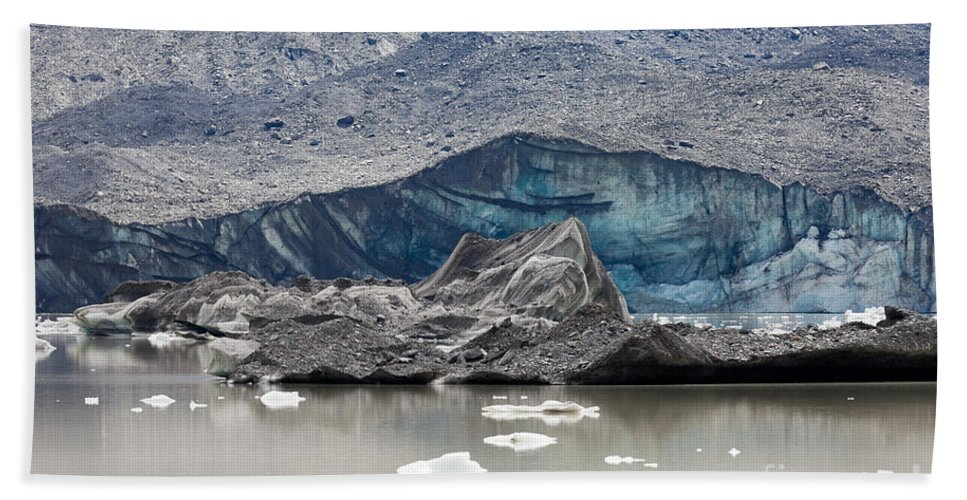 Blue Beach Towel featuring the photograph Glacier Tongue Calfing Icebergs Into Glacial Lake by Stephan Pietzko