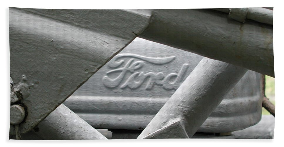 Ford Beach Towel featuring the photograph Grey Ford Tractor Logo by Anna Ruzsan