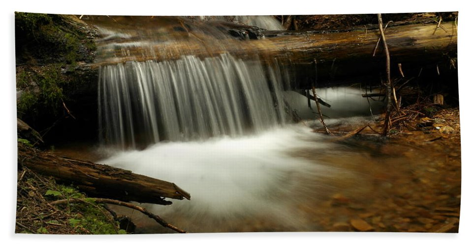 Water Beach Towel featuring the photograph Gurgling Over A Small Log by Jeff Swan