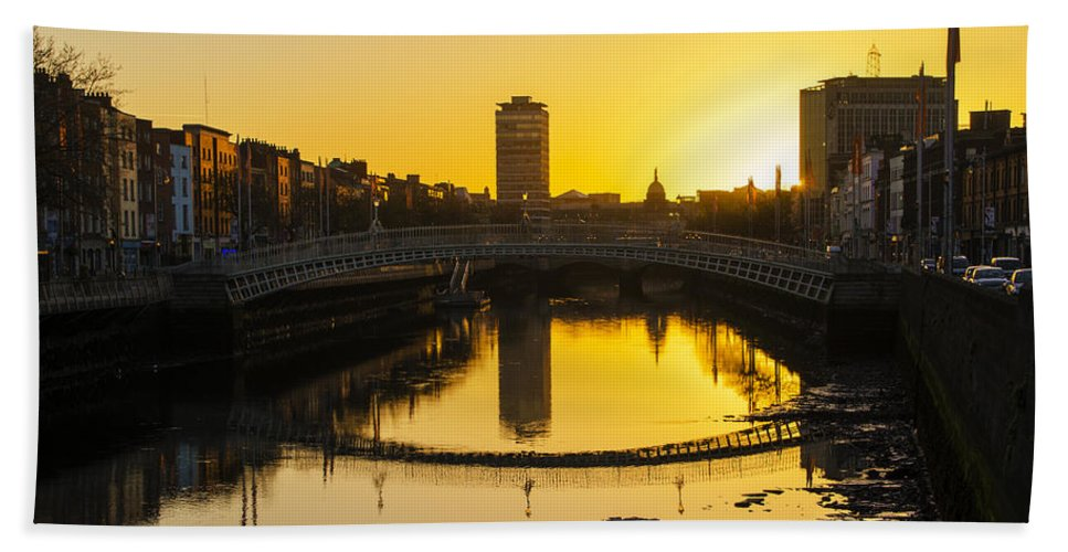 ha penny bridge at sunrise dublin ireland beach sheet for sale by