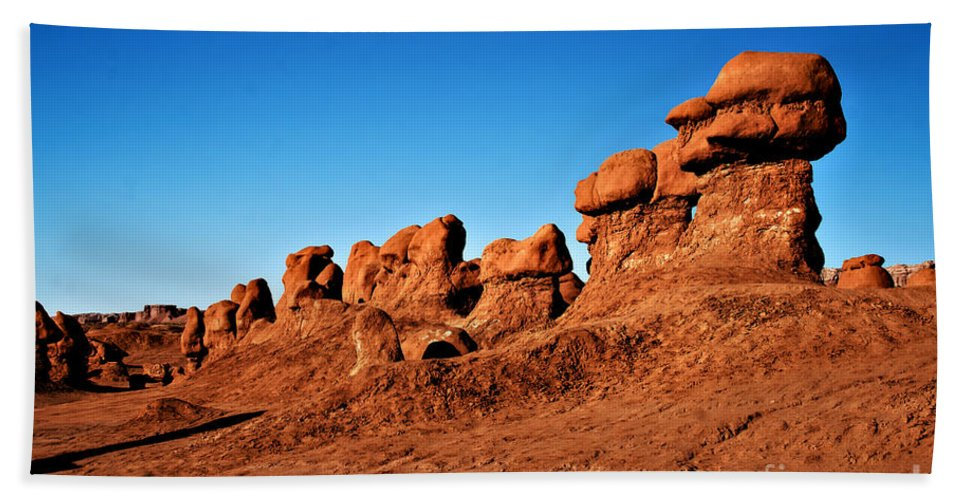 Goblin Valley Beach Towel featuring the photograph Hoodoos Row by Robert Bales