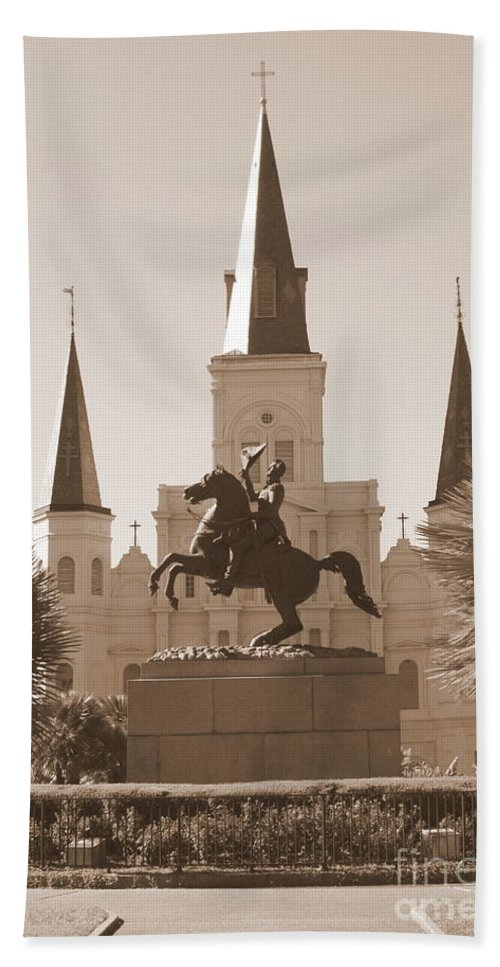 New Orleans Beach Towel featuring the photograph Jackson Square Statue In Sepia by Carol Groenen