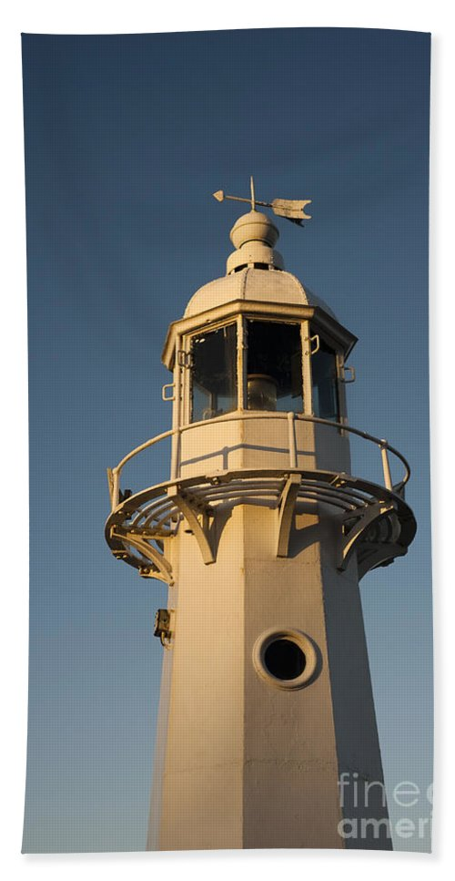 Autumn Beach Towel featuring the photograph Mevagissey Lighthouse In The Evening by Anne Gilbert