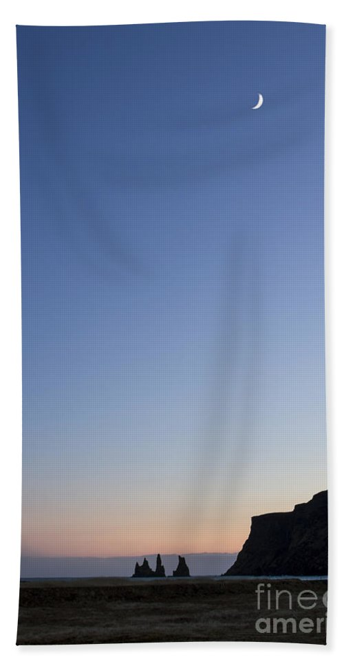 Vik Beach Towel featuring the photograph Moon Over Vik by Evelina Kremsdorf